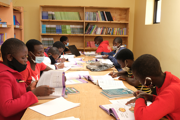 Image of Kuwala students studying with mask on for COVID-19.