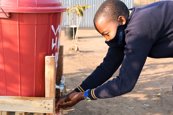 Image of Kuwala student washing hands