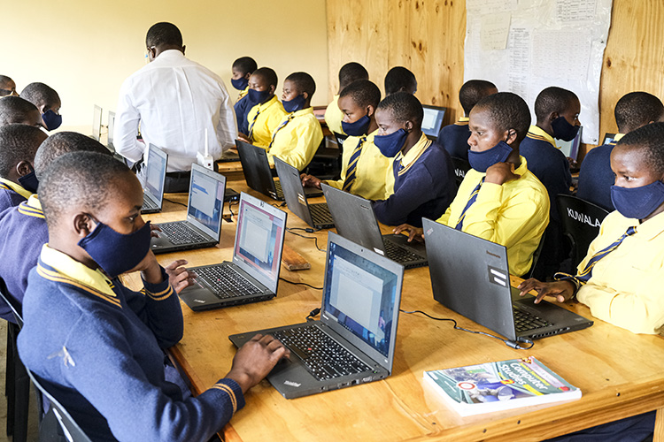 Image shows Kuwala students working in the Computer lab.