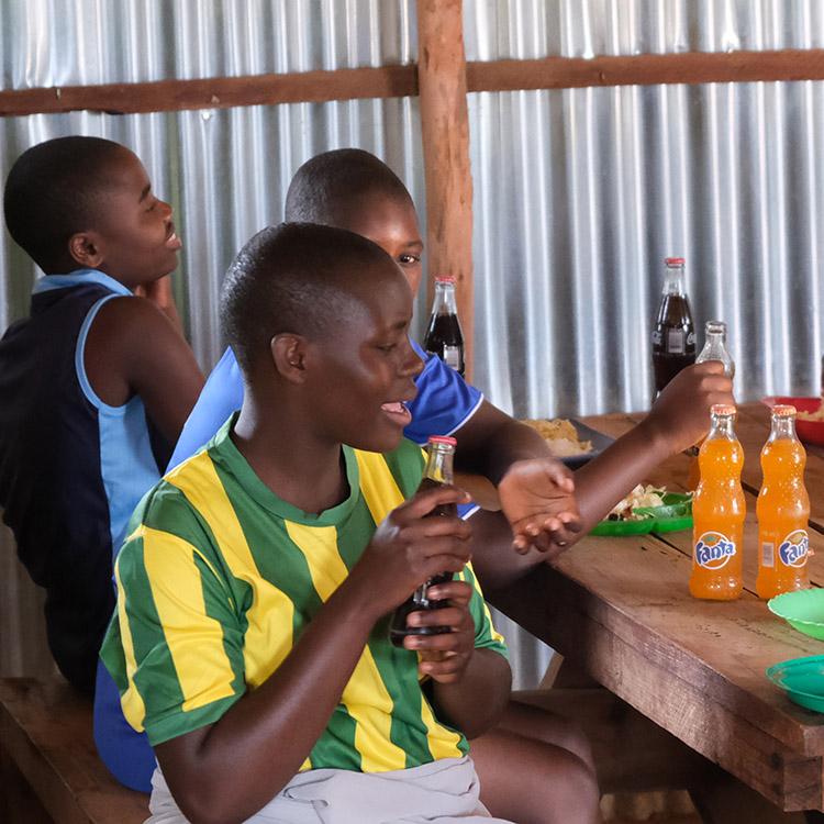 The Kuwala Girls enjoying a soda after Sports Day.