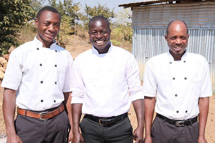The three culinary cooks employeed at the Kuwala Campus: Ndadayi, Chikumbutso and Jetel.