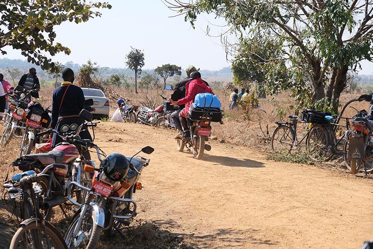 Motorbikes picking up students at the Kuwala Campus.