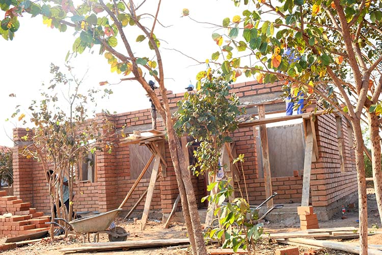 Kuwala second staff house construction with walls going up.